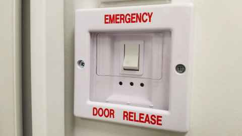 Emergency door release switch
