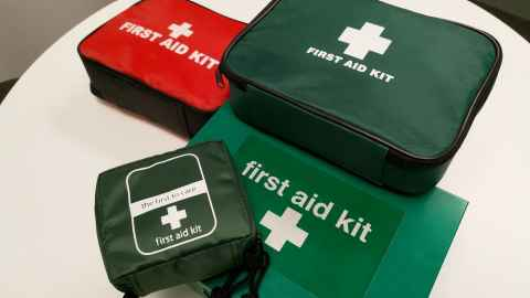 First aid kits at the University vary in size and colour.