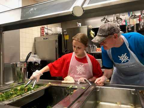 Helping prepare fresh meals at Part of the Solution, New York