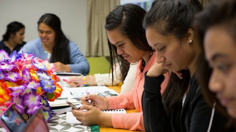 Māori and pacific postgraduate students studying together in a study area.