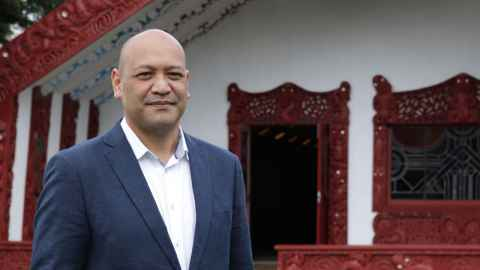 Man standing outside marae