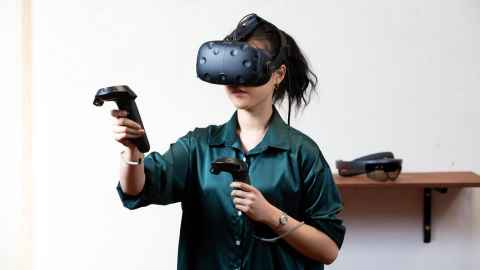 Graduate student testing virtual reality equipment