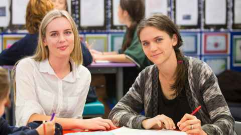 two EDSW students at desk