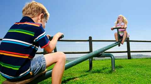Children on a seesaw