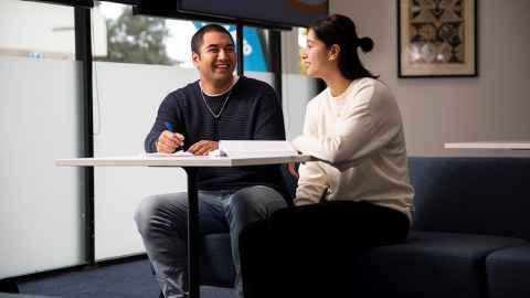 Students sitting at a desk in South Auckland Campus