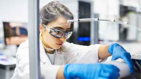 Student working in a liggins institute lab.