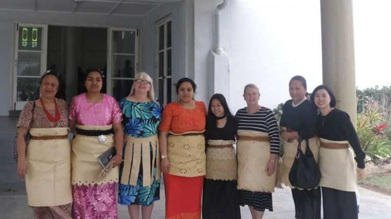 Clare and Kiki with the faculty delegation during an educational trip to Tonga in September.