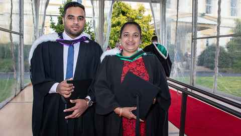 New teacher Rohini Lal is pictured, graduating with a Bachelor of Education (Teaching) on the same day as her son Ronish received a Bachelor of Engineering (Electrical).