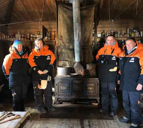 Juliet Gerrard (second from left) in Antarctica inside Shackleton's Hut Antarctica.