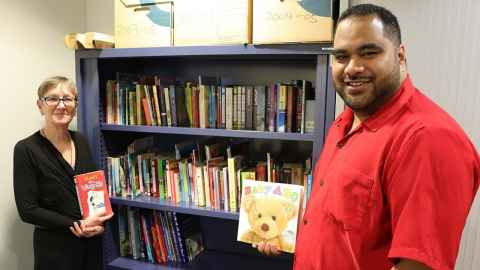 Sione Taufa and Herena Newall with donated books