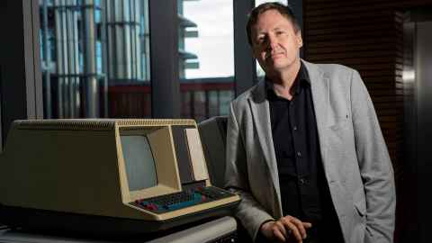 Professor Michael Witbrock, head of the Broad AI Lab, with a 1980s Digital Equipment Corp terminal.