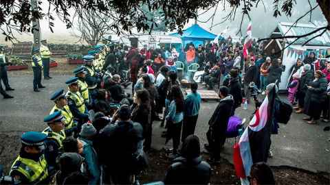 Protestors and police are pictured at Ihumātao. Photo: Julie Zhu Photography
