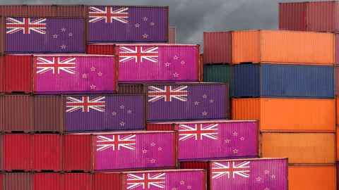 Containers stacked up, painted with the New Zealand flag, are pictured: Traditional trade is being disrupted by new technologies. Photo:iStock