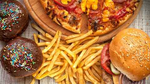 Fast food is pictured - burgers, pizza, doughnuts and hot chips: Globally, 11 million deaths are attributable to dietary factors every year. Photo: iStock