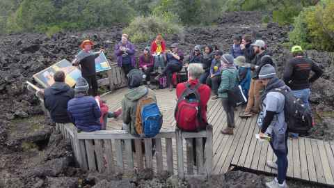Enthusiasm eruption: Bruce Hayward talks to school science teachers from New Zealand, Australia and the United States on Rangitoto Island.