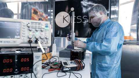 Aiming high: A student works on a CubeSat in the Auckland Programme for Space Systems (APSS) lab.