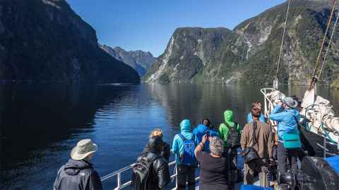 Tourists to NZ are photographed looking out onto the beauty of Doubtful Sound, one of the visitor attractions of Fjiordland. Photo: iStock