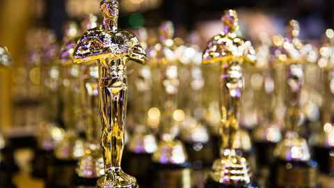 Oscar statues are pictured in a row: In more than 90 years of the Academy Awards, the Oscar for best original film score has only been won by a female composer three times. Photo: iStock