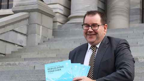Finance Minister Grant Robertson is pictured on the steps of Parliament with this year's Budget. Photo: Lynn Grieveson