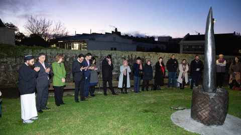Guests at the dawn blessing for  the unveiling of the memorial