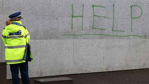 The image show the word 'Help' written on the Beehive wall on the day of a protest against uplifts of Maori children by Oranga Tamariki. Social work is increasingly about cost-effective discipline of the disadvantaged, writes Ian Hyslop. Photo: Lynn Grieveson, Newsroom