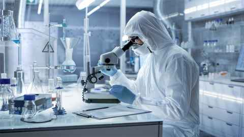 An image show a scientist dressed in protective clothing working in a laboratory: Scientists are doing their work and investing additional time  in explaining why armchair reckons are unreliable and misguided. Photo: iStock
