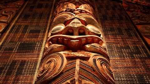 The image shows an intricate Māori carving in a meeting house: The rich opportunities, strengths and values offered by Māori have been too long overlooked while the inequities suffered are renown. Photo: iStock