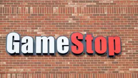The image shows a GameStop shop sign on a brick wall: The real takeaway from the trading frenzy over GameStop is the surging undercurrent of frustration driving WallStreetBets to enter the fray in the first place. Photo: iStock