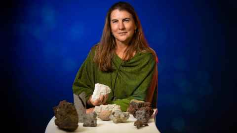 Professor Jan Lindsay holding some volcanic rocks.