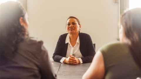 The image shows a female business leader at the table: Diversity at leadership level should improve a board's ability to make well-informed decisions. Photo: iStock