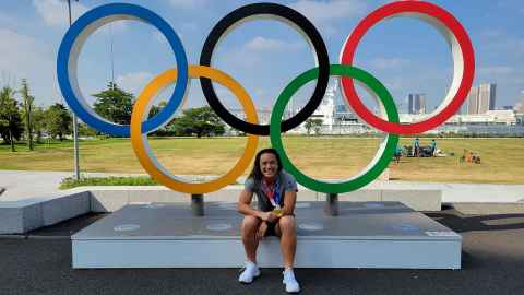 Theresa Fitzpatrick at the Tokyo Olympics proudly sporting the gold won with the women's Sevens side.