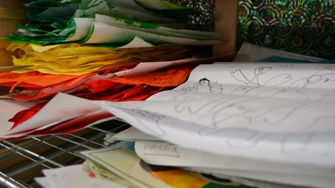 Coloured papers and children' drawings