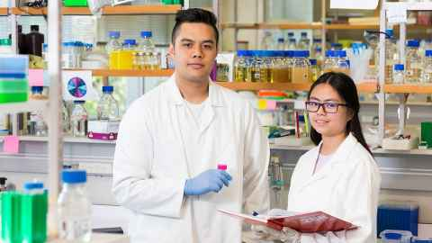 Biological sciences student Omni Arona (on left)