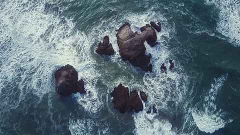 Heavy waves crashing on rocks from above
