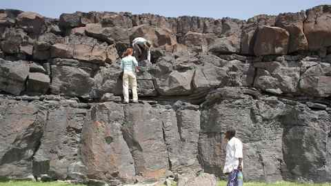 Researchers looking at volcanic stratigraphy in Afar, Ethiopia
