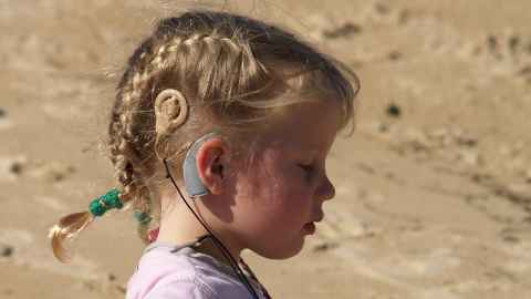 Child wearing cochlear implant, Flickr, Matt Ralph