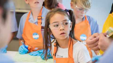 Young girl listening to instructions at BASF Kids Lab 2017