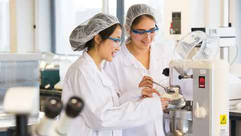 Two students working in the Food Sciences lab