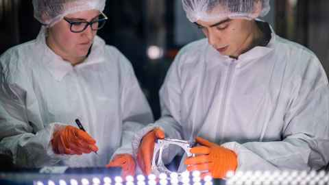 Scientists working in a clean room at NIWA