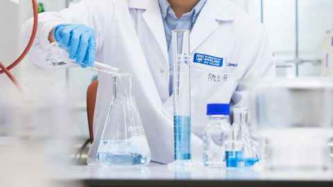 Chemical science researcher in lab detail