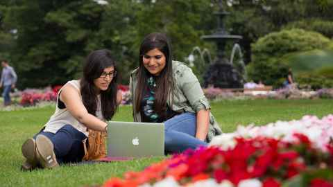 Image showing two girls using a computer outdoors