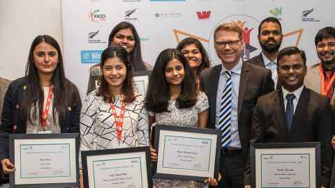 NZEA scholarship winners and Minister of Education Paul Goldsmith