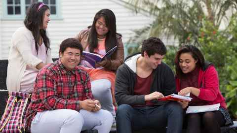 Five pacific students studying outside