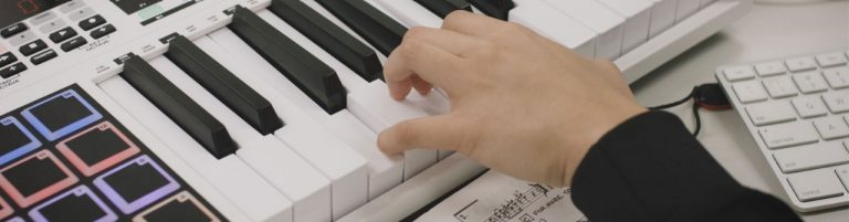 Student playing music on keyboard, used as a header banner image for Bachelor of Arts/Bachelor of Music conjoint.