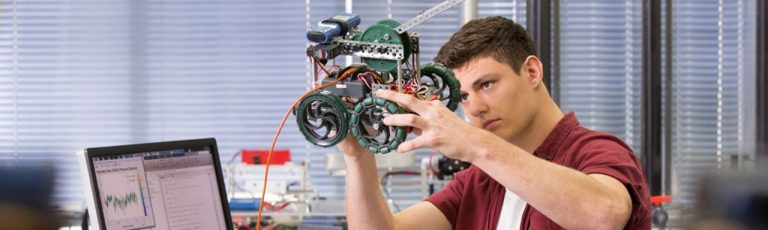 A student assessing a motor model