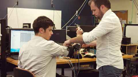 Dr Andrew McDaid and a postgraduate student testing a robotics rehabilitation device.